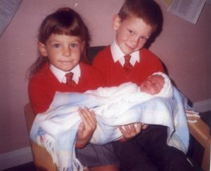 Emma with her brother and baby sister